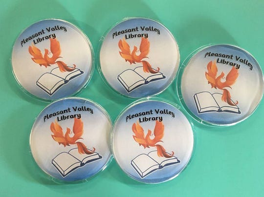 Local businesses are selling buttons for $3 to raise money for the revival of the Pleasant Valley Free Library.