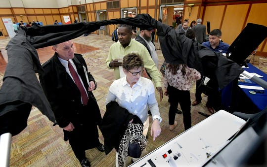 Paula and Fred Sembach, of Dauphin County, are advised by Willie Wesley, Jr, director of business development for Election Systems and Software, background, while sampling a voting machine at the New Voting Systems Expo hosted by the Pennsylvania Department of State at Dickinson College Wednesday, Dec. 12, 2018. Fred is chief of staff to State Senator Mike Folmer. Pennsylvania counties are preparing to replace voting machinesafterGov. Tom Wolf in April mandatedthat voting machines used in the state have a verifiable paper trail. Bill Kalina photo