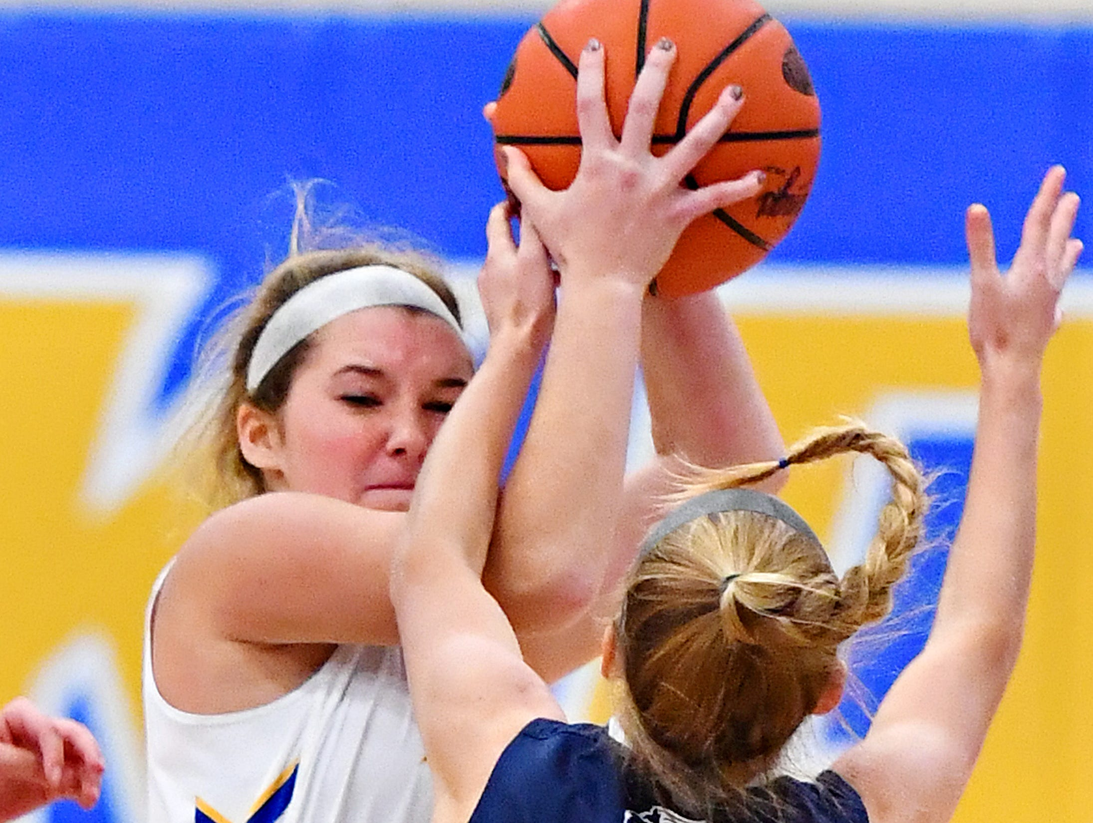 Kennard-Dale's Mikayla Hostler, left, works to get the ball past Camp Hill's Ava Brackett during girls' basketball action at Kennard-Dale High School in Fawn Grove, Wednesday, Dec. 12, 2018. Kennard-Dale would win the game 47-28. Dawn J. Sagert photo