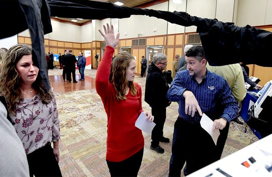 Cumberland County Elections representatives Megan Orris, and Bethany Salzarulo, left, talk with Grant Matthews, of William Penn Printing, while sampling a voting system by election Systems Software at the New Voting Systems Expo hosted by the Pennsylvania Department of State at Dickinson College Wednesday, Dec. 12, 2018. Pennsylvania counties are preparing to replace voting machinesafterGov. Tom Wolf in April mandatedthat voting machines used in the state have a verifiable paper trail. Bill Kalina photo