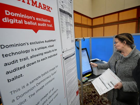 Trina Reddish of Dauphin County samples a voting machine by Dominion Voting at the New Voting Systems Expo hosted by the Pennsylvania Department of State at Dickinson College Wednesday, Dec. 12, 2018. Pennsylvania counties are preparing to replace voting machinesafterGov. Tom Wolf in April mandatedthat voting machines used in the state have a verifiable paper trail. Bill Kalina photo