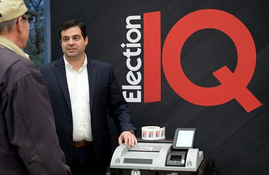 Daniel Chalupsky, Vice president of ElectionIQ, talks with a person attending the New Voting Systems Expo hosted by the Pennsylvania Department of State at Dickinson College Wednesday, Dec. 12, 2018. Pennsylvania counties are preparing to replace voting machines after Gov. Tom Wolf in April mandated that voting machines used in the state have a verifiable paper trail. Bill Kalina photo