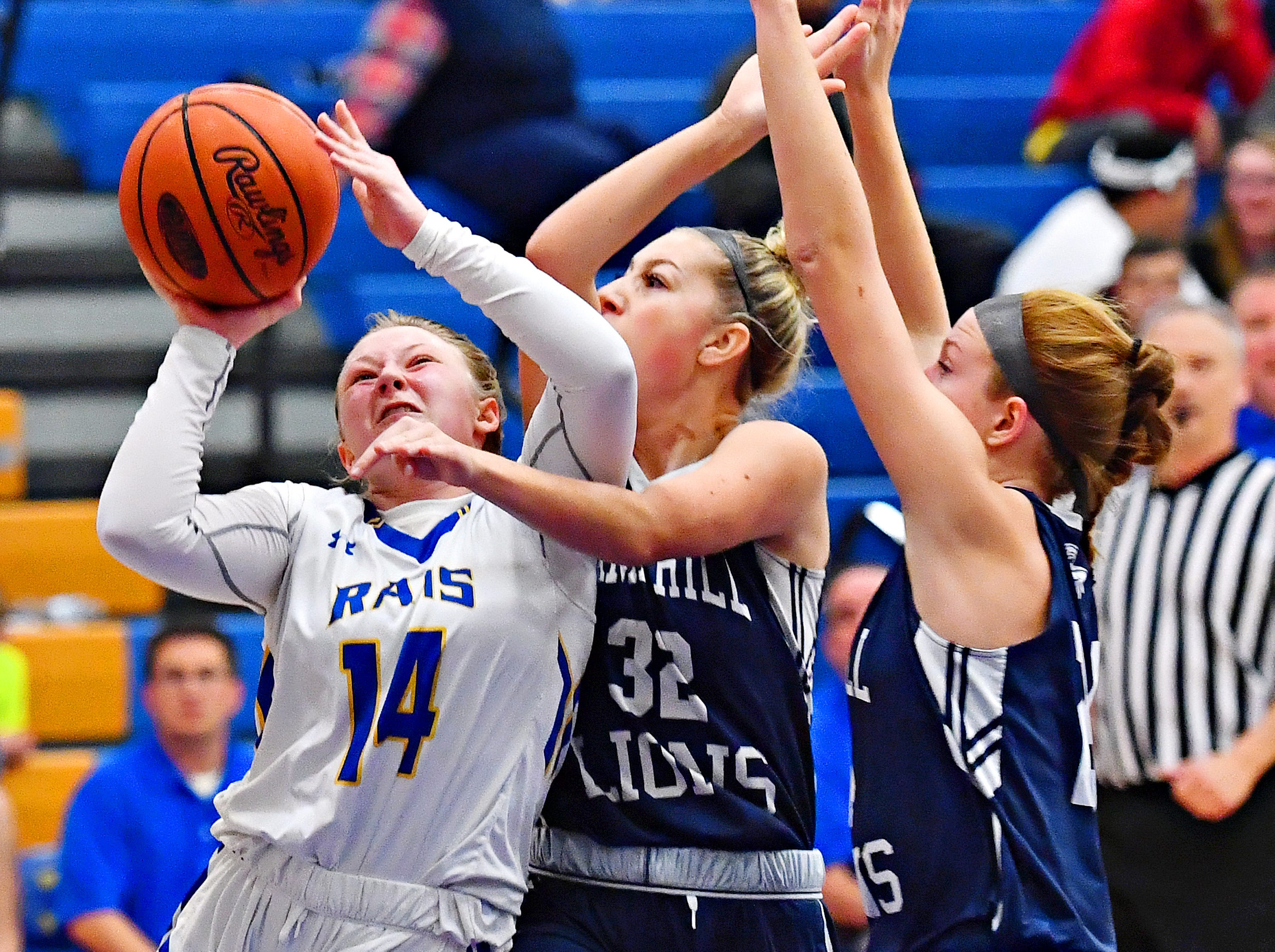 Kennard-Dale's Chandler Swanson, left, takes the ball to the hoop while Camp Hill's Sheridan Reid, center, and Ellie Goodwin defend during girls' basketball action at Kennard-Dale High School in Fawn Grove, Wednesday, Dec. 12, 2018. Kennard-Dale would win the game 47-28. Dawn J. Sagert photo