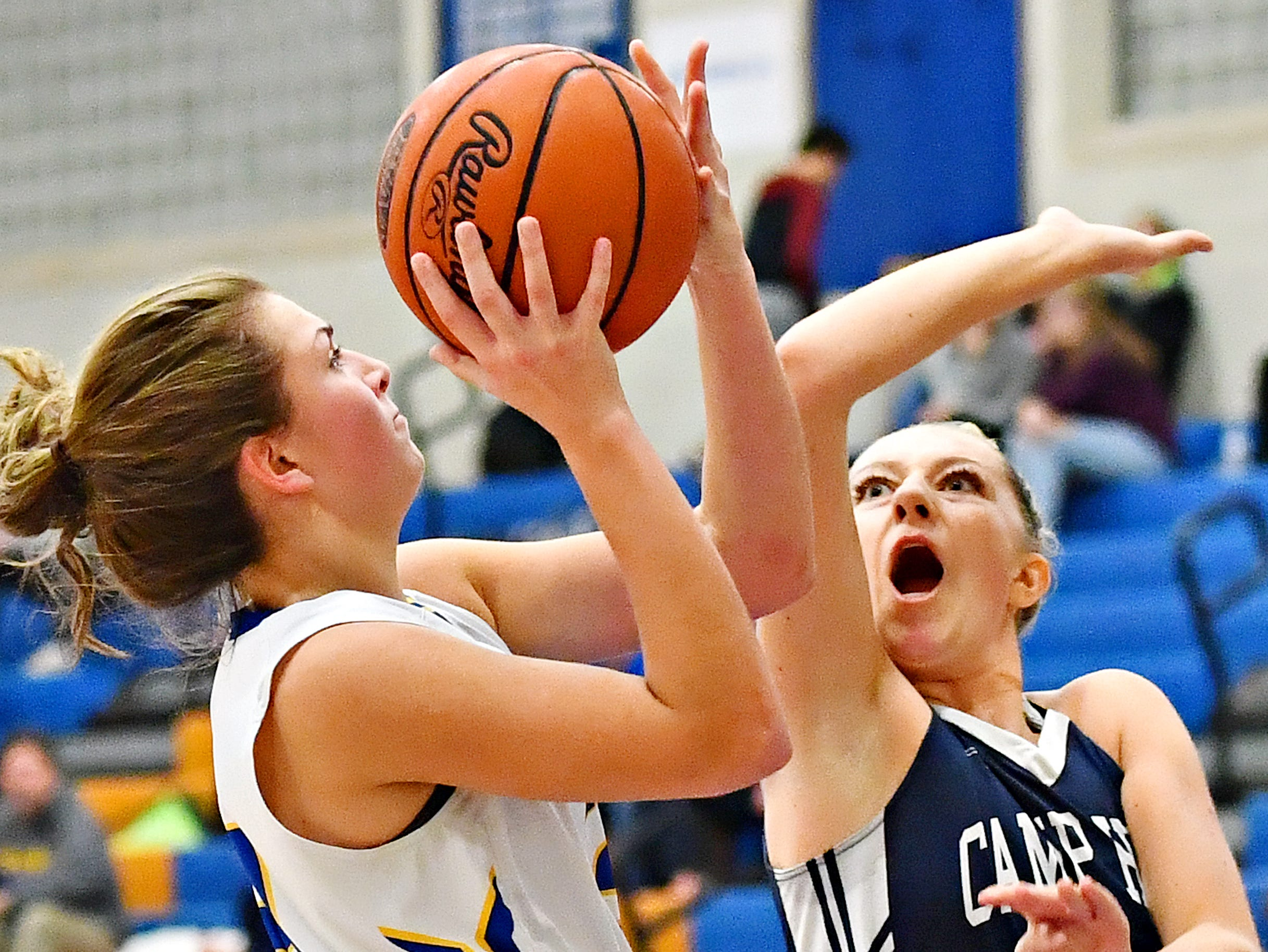 Kennard-Dale's Jaedyn McKeon, left, is fouled by Camp Hill's Sheridan Reid during girls' basketball action at Kennard-Dale High School in Fawn Grove, Wednesday, Dec. 12, 2018. Kennard-Dale would win the game 47-28. Dawn J. Sagert photo