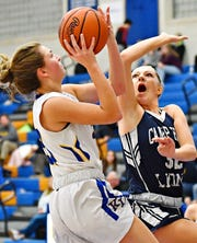 Kennard-Dale's Jaedyn McKeon, left, is fouled by Camp Hill's Sheridan Reid during girls' basketball action at Kennard-Dale High School in Fawn Grove, Wednesday, Dec. 12. McKeon is one of the leaders of a K-D team that went 20-2 during the regular season.