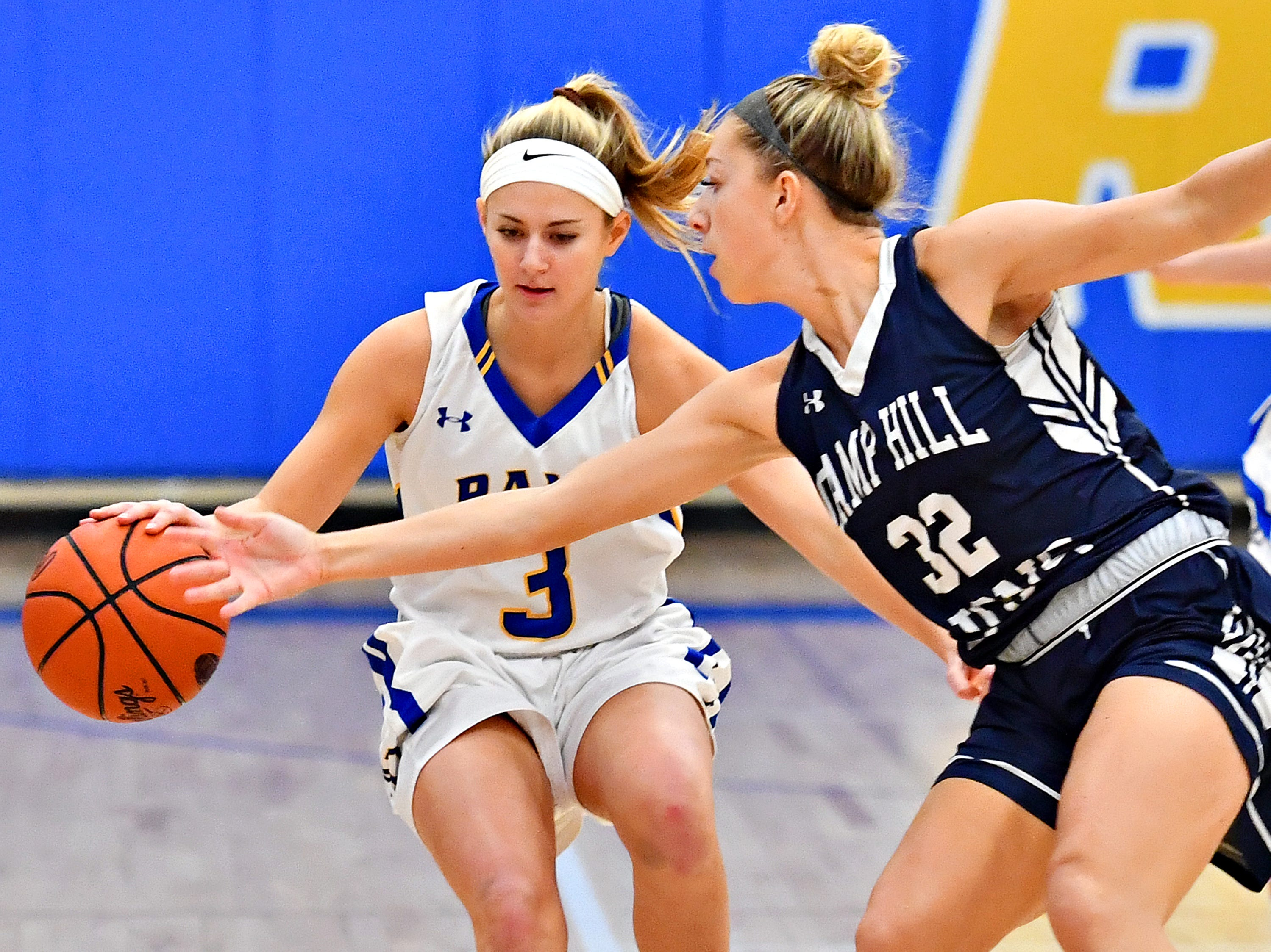 Camp Hill's Sheridan Reid, right, works to hit the ball away from Kennard-Dale's Megan Halczuk during girls' basketball action at Kennard-Dale High School in Fawn Grove, Wednesday, Dec. 12, 2018. Kennard-Dale would win the game 47-28. Dawn J. Sagert photo