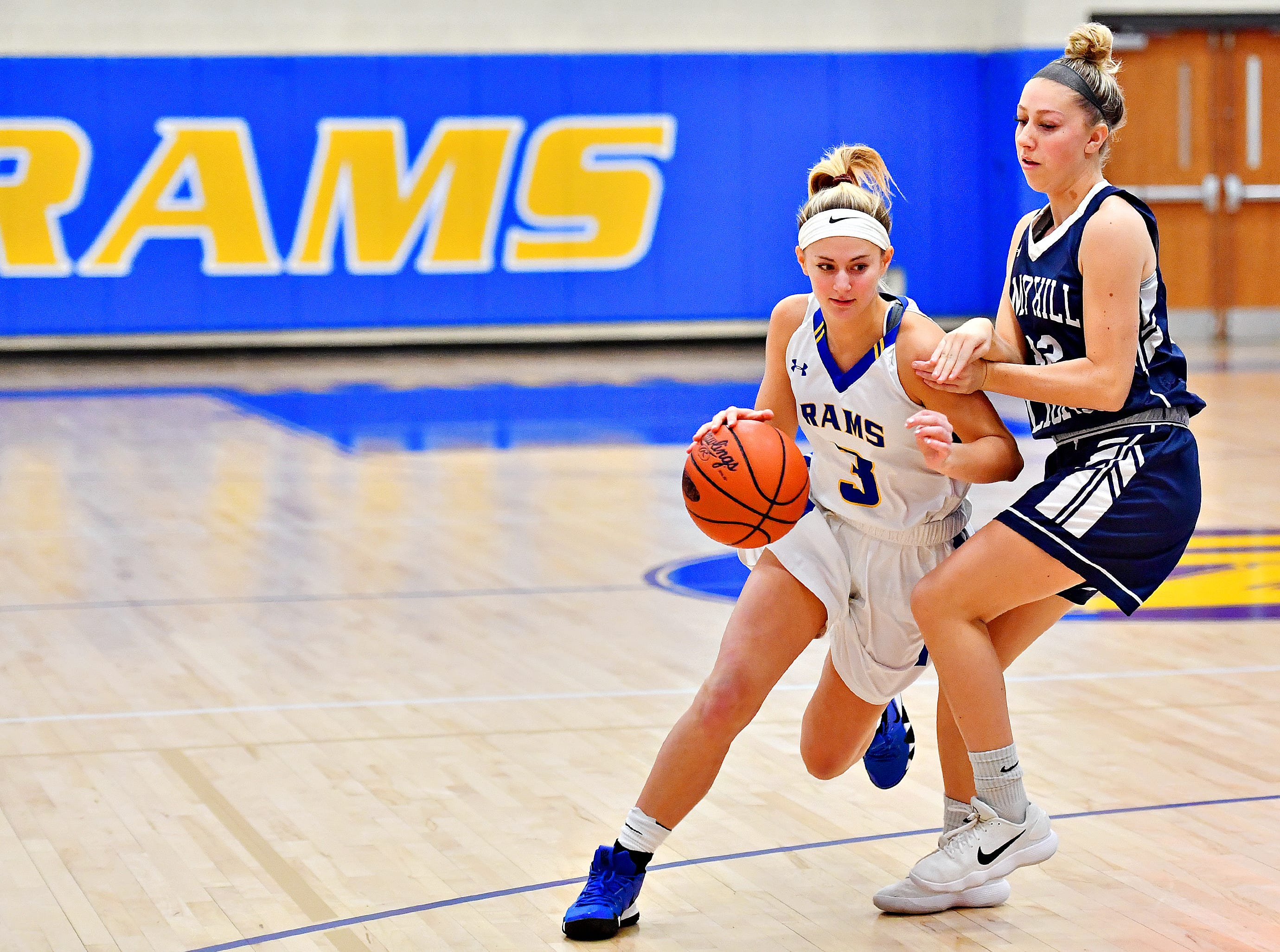 Kennard-Dale's Megan Halczuk, left, works to get around Camp Hill's Sheridan Reid during girls' basketball action at Kennard-Dale High School in Fawn Grove, Wednesday, Dec. 12, 2018. Kennard-Dale would win the game 47-28. Dawn J. Sagert photo