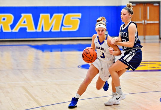 Kennard-Dale's Megan Halczuk, seen here at left in a file photo, scored 10 points for the Rams in Saturday's overtime win over Gettysburg. Halczuk scored the basket that sent the game into OT.