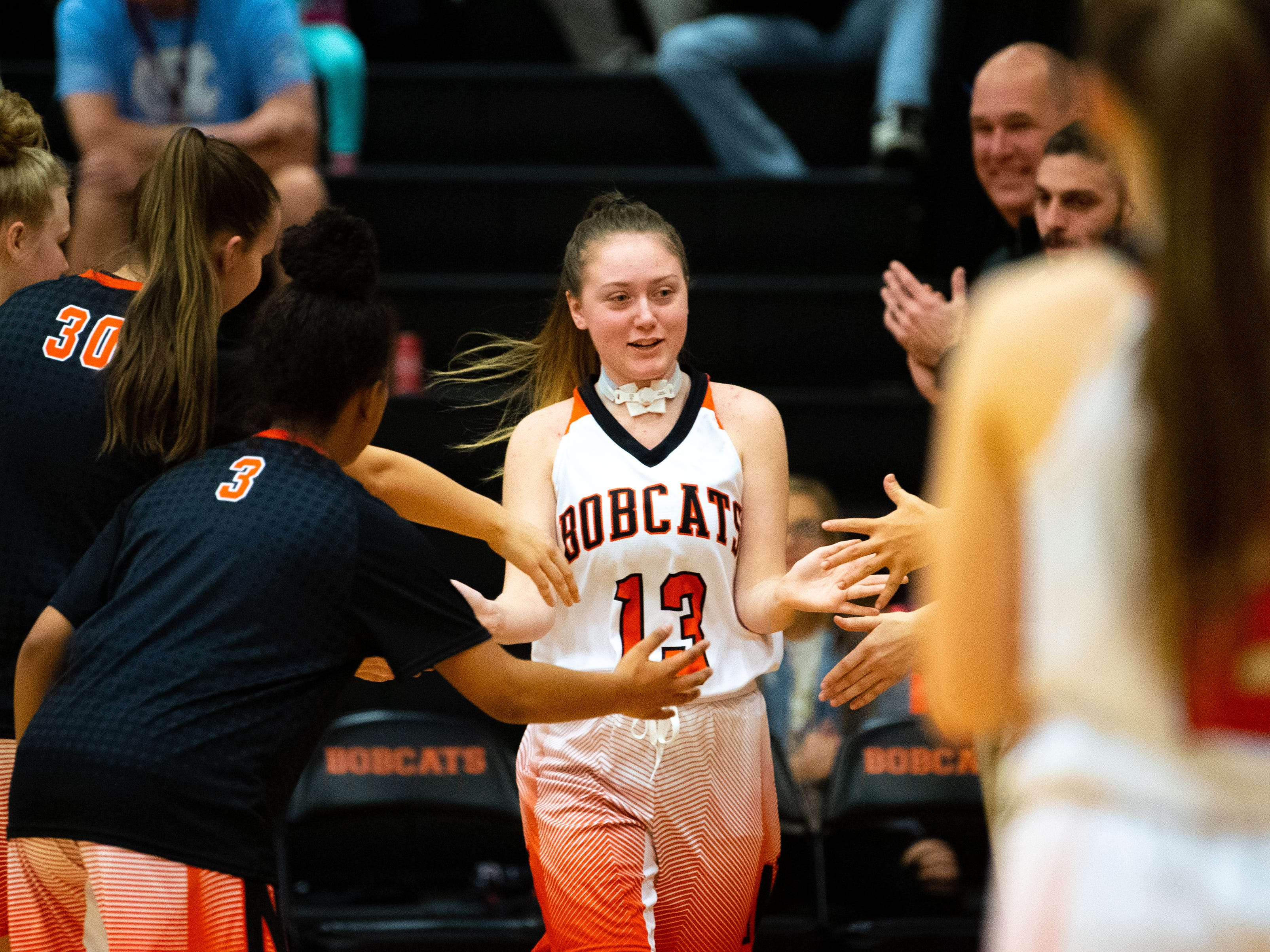 Audrey Johnson's teammates happily welcome her to the floor, December 12, 2018.