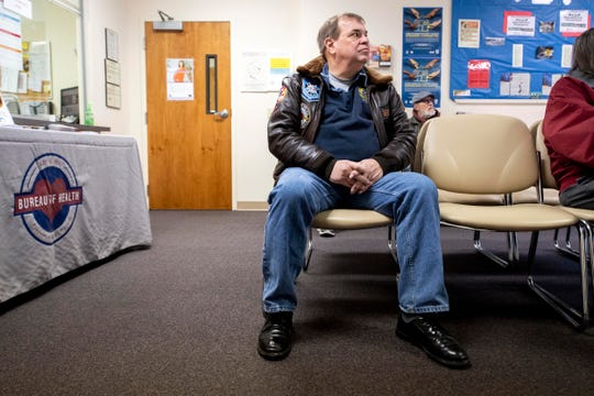 Micheal McGurl, a paramedic with over 40 years in healthcare, watches the informative video about administering Narcan, prior to receiving a free kit of the drug at the Bureau of Health building in York on Thursday. McGurl has concerns about the program but feels that he has a moral obligation to keep it with him, since he sees some overdoses in his daily walks along the Susquehanna River.