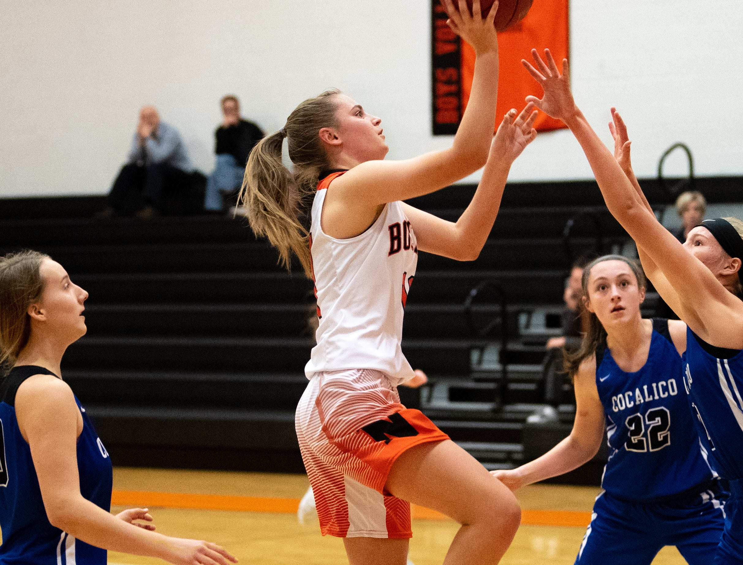 Megan Elzinga (11) lays the ball up during their game against Cocalico, December 12, 2018.