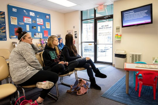 From left, Amanda Karst, Jenna Hendershot and Alexandra Robbins watch the educational video about using Narcan, at the Bureau of Health in York. All three have had Narcan used on them and are in recovery. Hendershot, 27, attributes her life today to the Narcan. She's now two years clean.