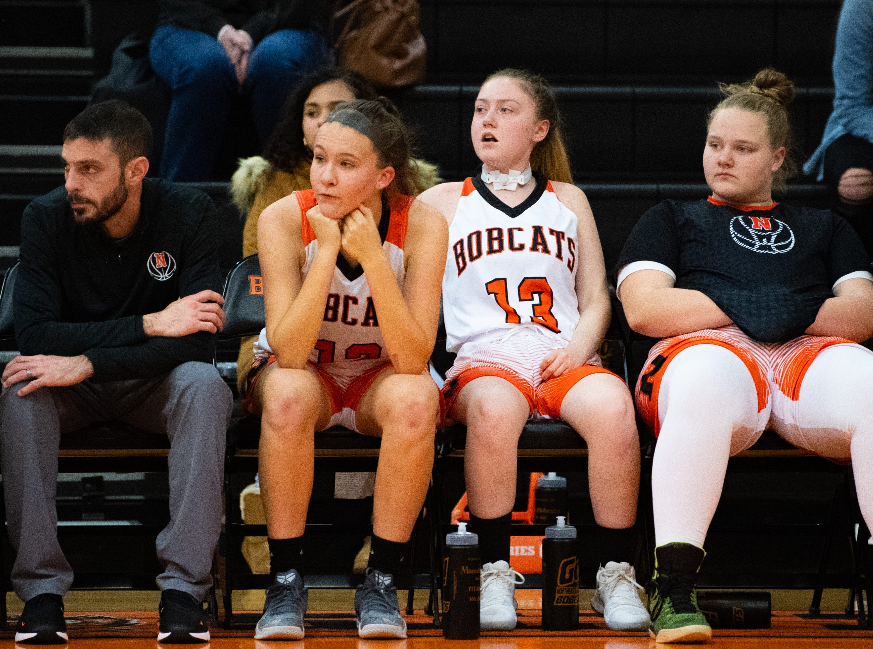 After scoring the opening basket, Audrey Johnson (13) goes to the bench to avoid injury, December 12, 2018.