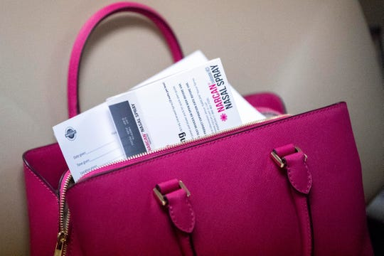 A Narcan kit is seen poking out of a purse. People had a variety of reasons for obtaining the free medication, whether it was to help a friend or family member, or even a perfect stranger.