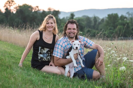 Jason Kunselman and his wife, Kristy, shown in a family photo. Kunselman  gave up his seat to a mom with an ailing baby on a flight earlier this month.