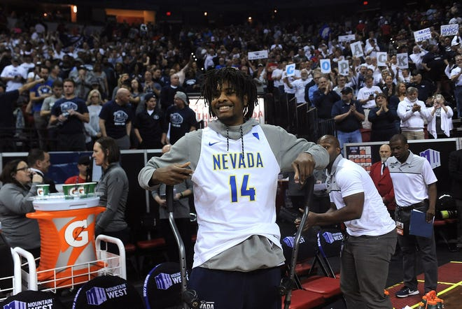 Nevada's Lindsey Drew smiles after his teammates defeated UNLV during the Mountain West Tournament in March.