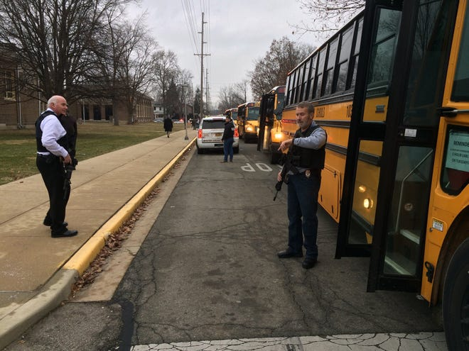 Buses wait to take Dennis Intermediate School students to Civic Hall at Richmond High School so parents can pick them up after a report of shots being fired at Dennis on Thursday morning.