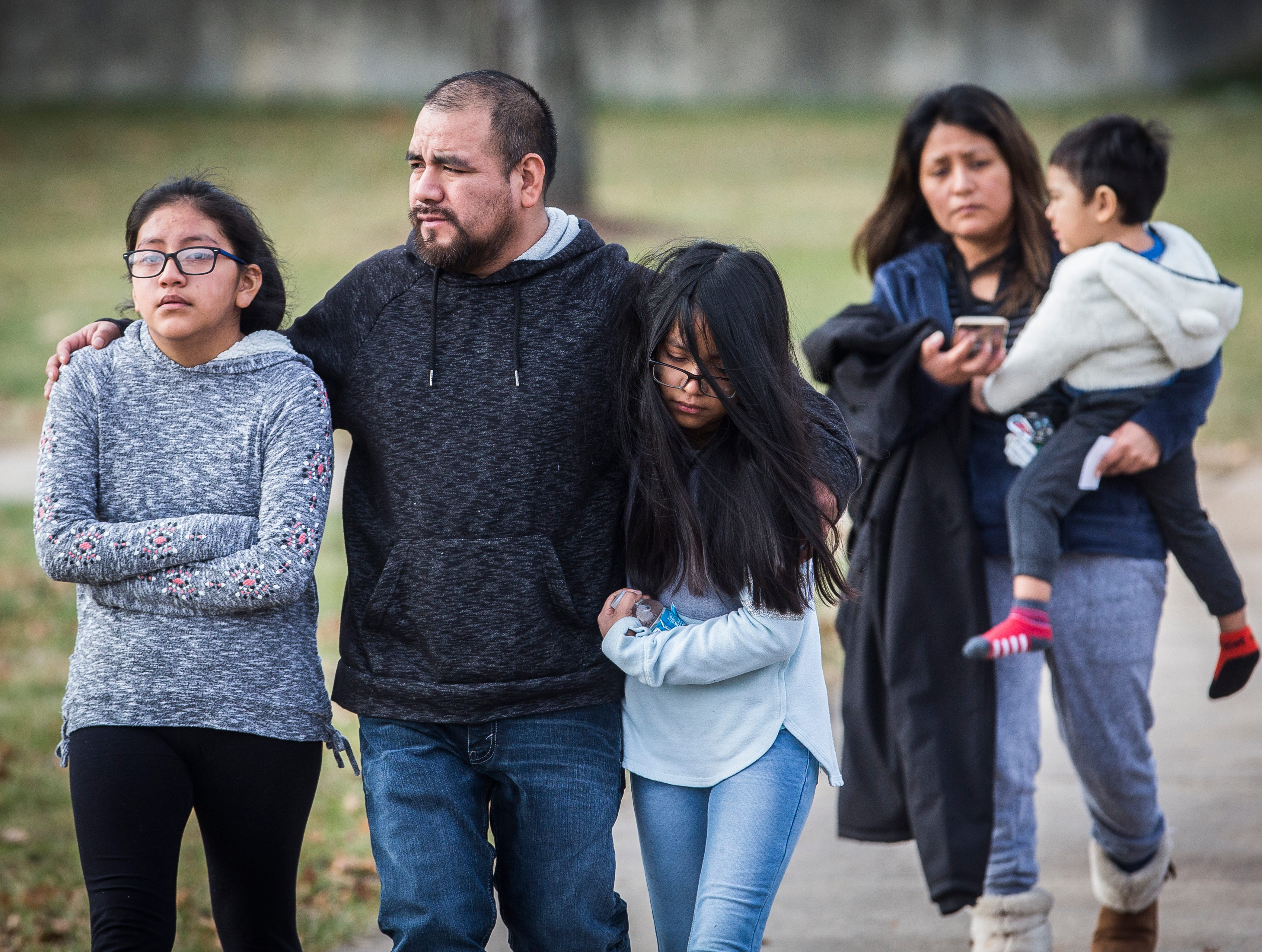 Hundreds of families gather at the Civic Hall Performing Arts Center in Richmond to reunite with their children after an attempted shooting occurred at Dennis Middle School Thursday morning.