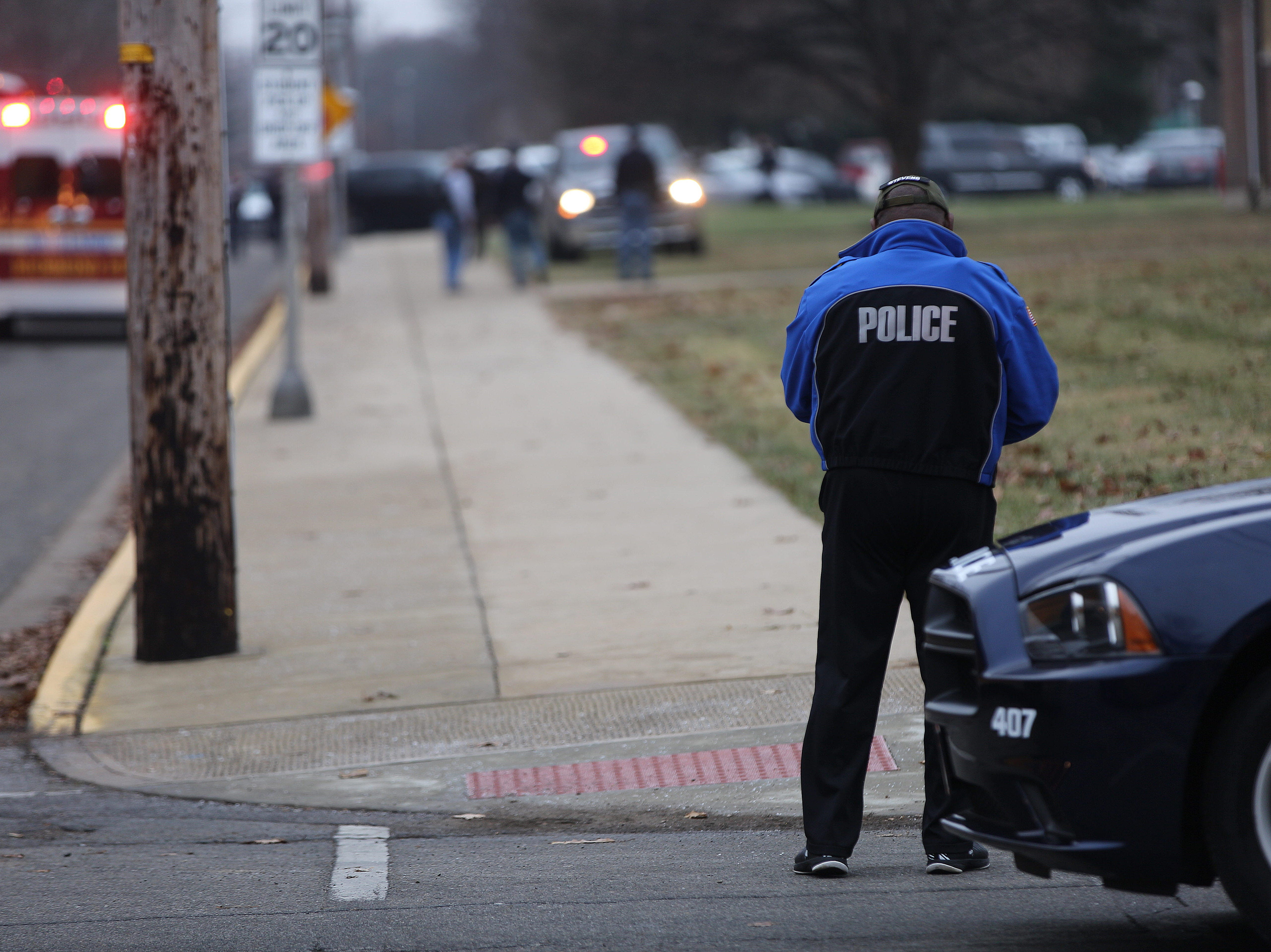 Police escort children onto buses as Dennis Intermediate School is evacuated Thursday following an active shooter on the campus. The only fatality at the school was the shooter who reportedly took his own life.