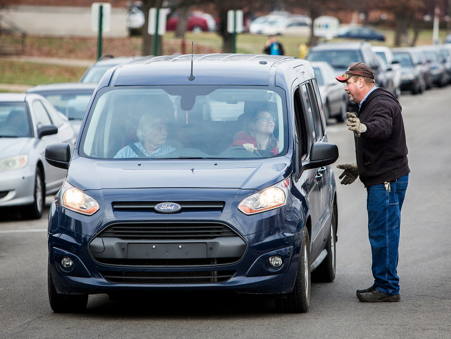 Hundreds of cars fill the parking lot and line the street outside of the Civic Hall Performing Arts Center where parents waited to reunite with their children following a shooting at Dennis Intermediate School Thursday morning.
