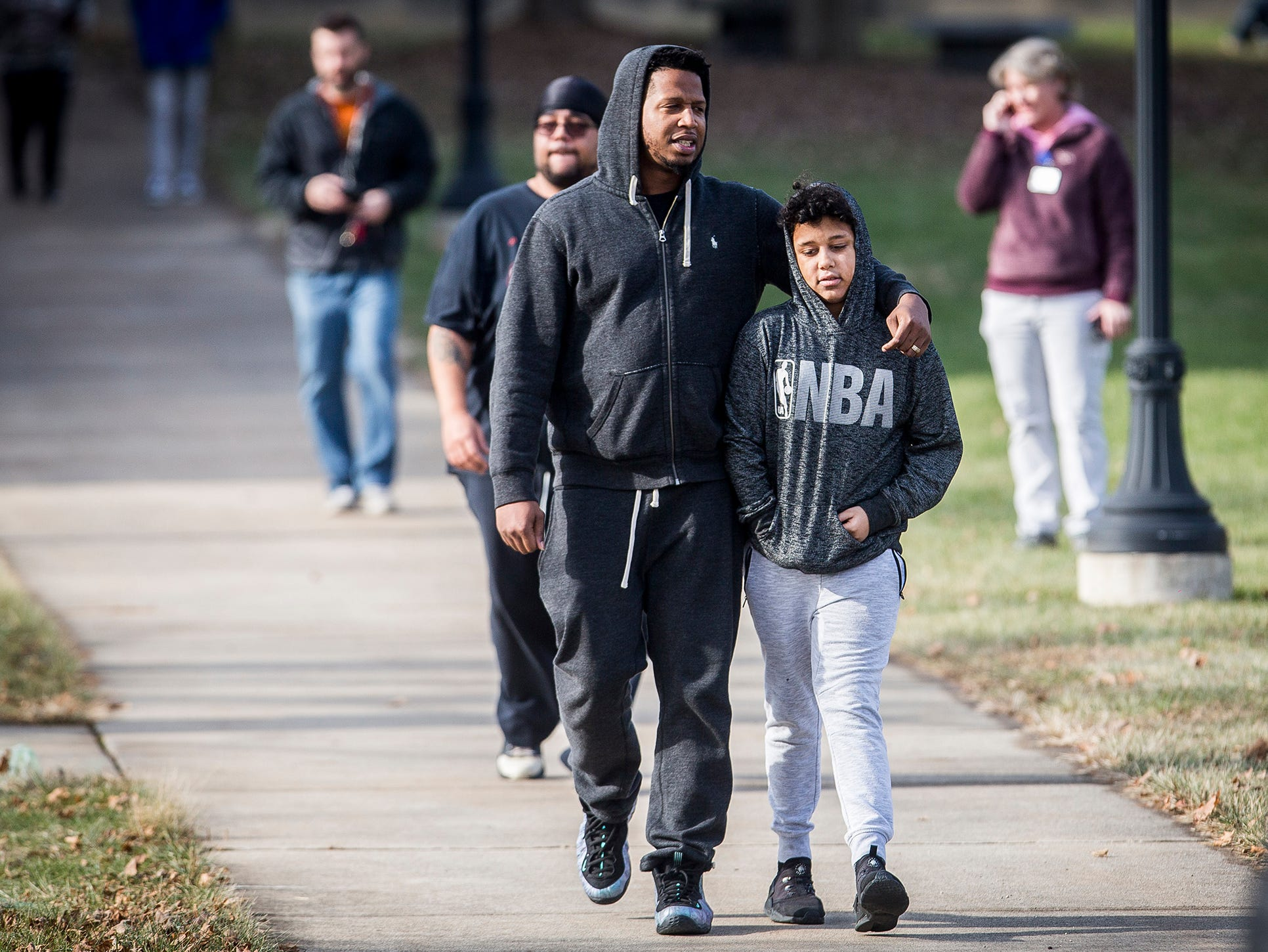 Hundreds of families waited to reunite with children at the Civic Hall Performing Arts Center where students waited after being bussed from Dennis Intermediate School following a shooting Thursday morning.