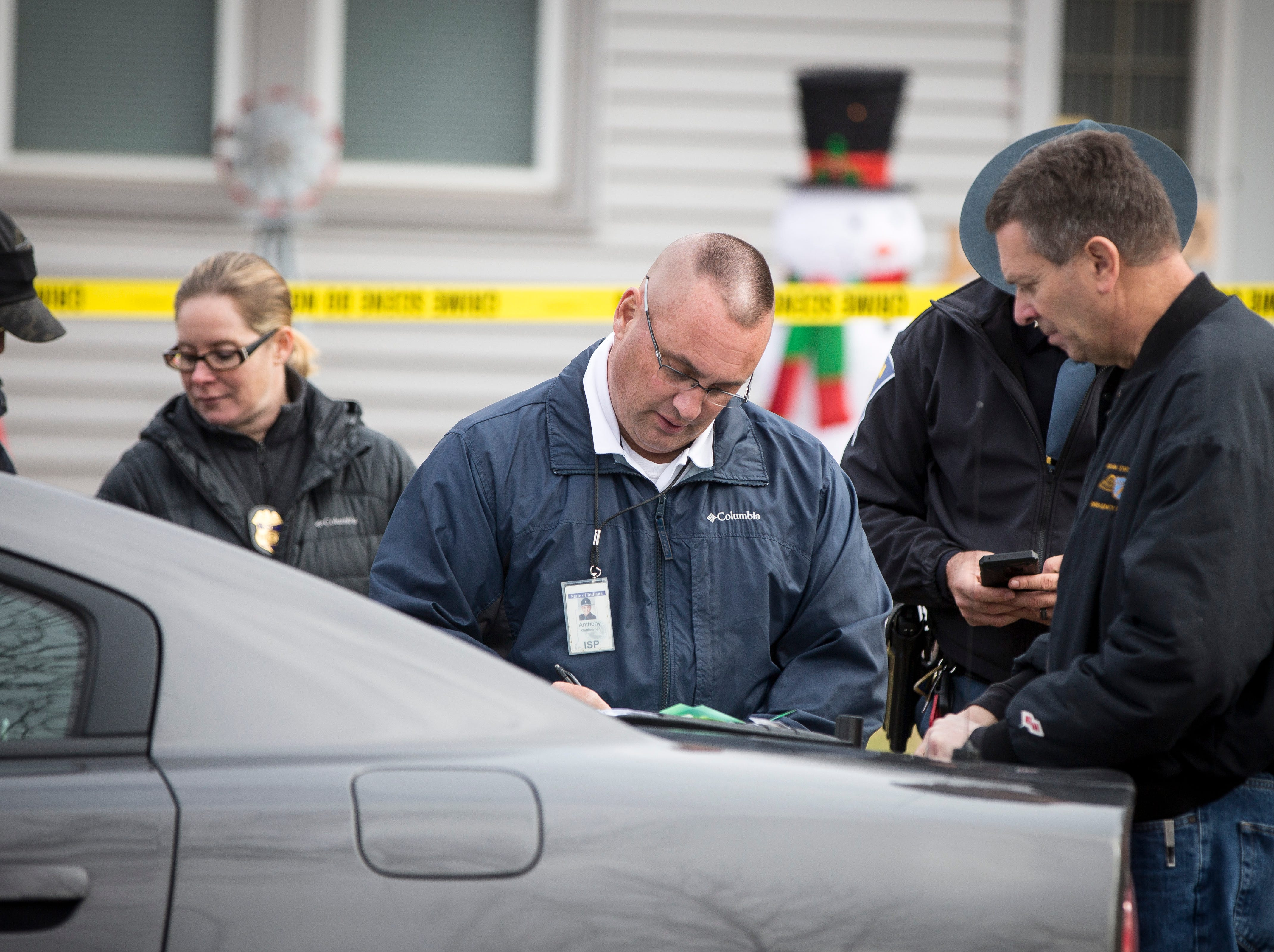 Police enter the residence at the 100 block of S.W. 16th St. with a search warrant related to the active shooter at Dennis Intermediate School on Thursday morning. While no one was injured at the school, the teenage suspect took his own life after an altercation with police.