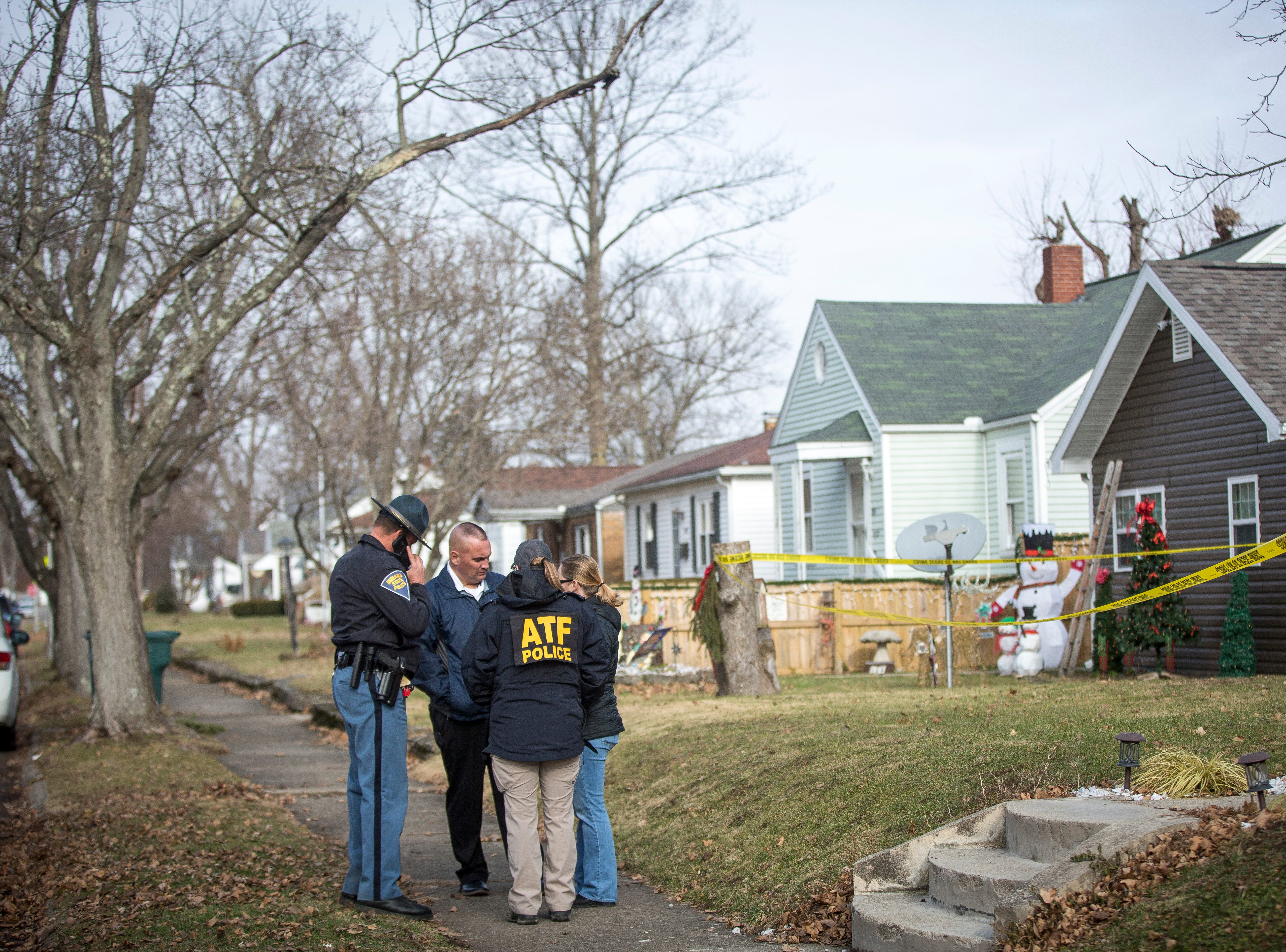Police enter a residence in the 100 block of S.W. 16th St. with a search warrant related to the active shooter at Dennis Intermediate School. The teenage suspect took his own life after an altercation with police at the school.