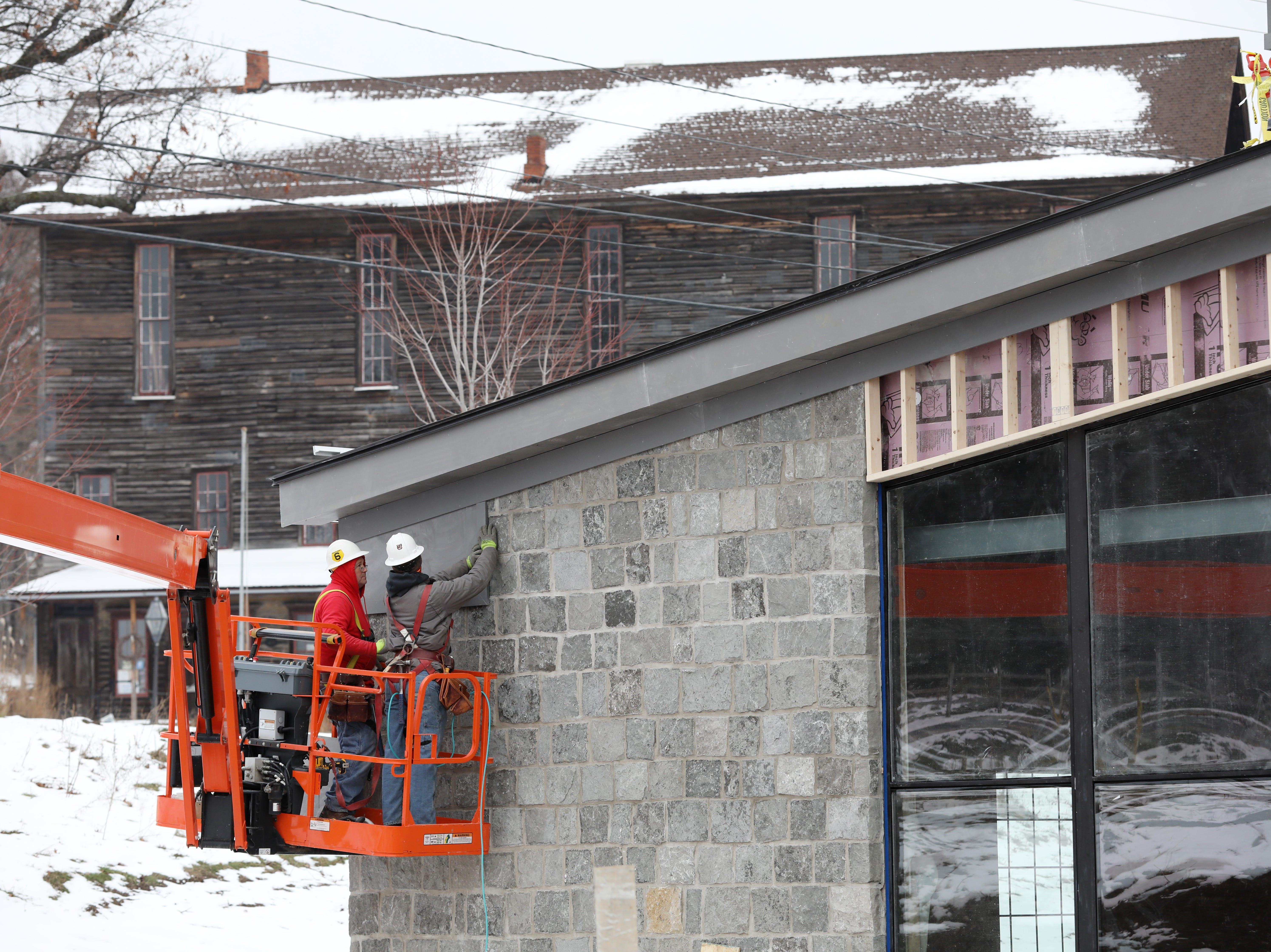 Finish work on the exterior of New York Beer Project in Victor.