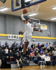 Irondequoit's Patrick Thomas drives uncontested for a dunk during a regular season game against Webster Schroeder played at Irondequoit High School, Wednesday, Dec. 12, 2018.