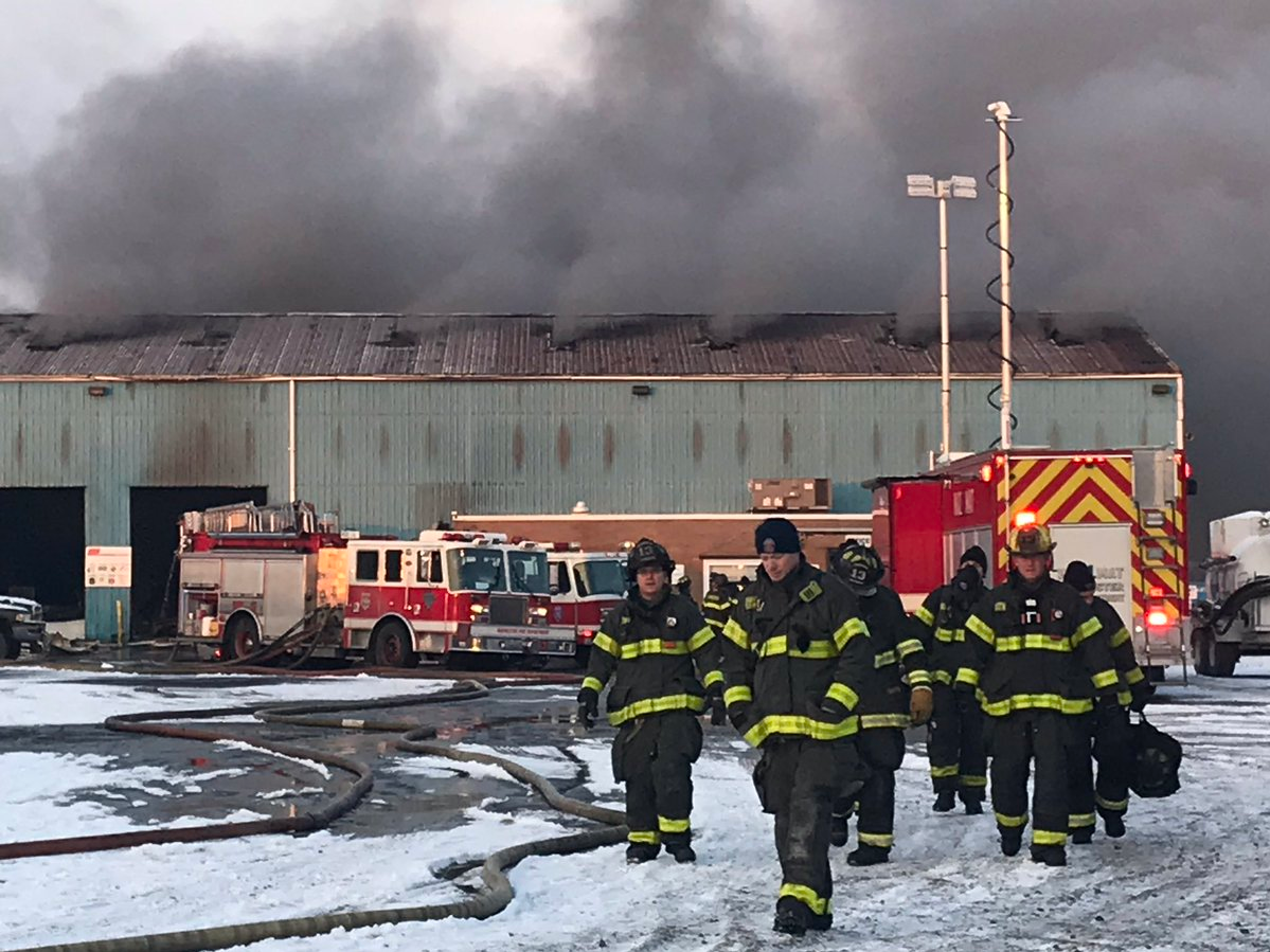 Firefighters battle a large fire at a warehouse on Cairn Street in Rochester on Thursday.