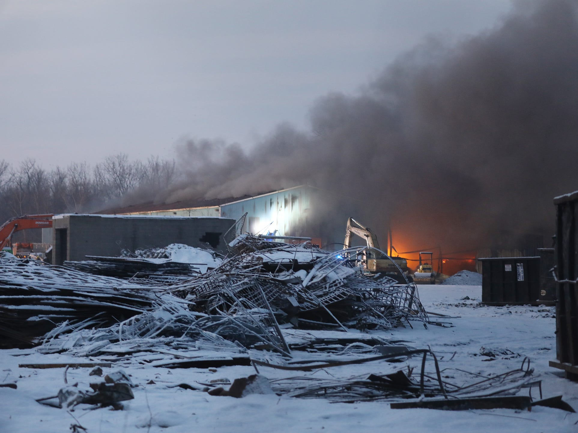 Rochester firefighters battle a three-alarm fire at a warehouse on Cairn Street.