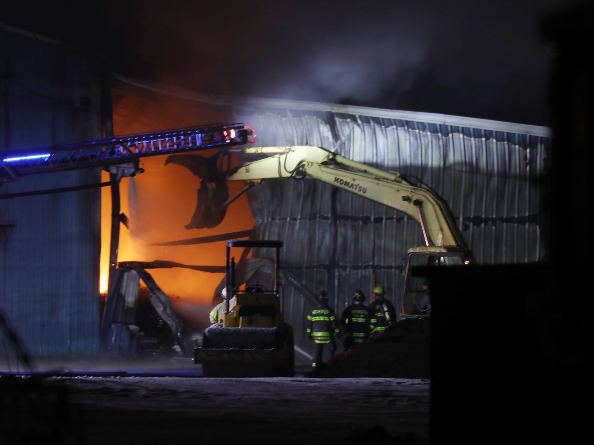 A backhoe was used to open up the building to get at the fire.