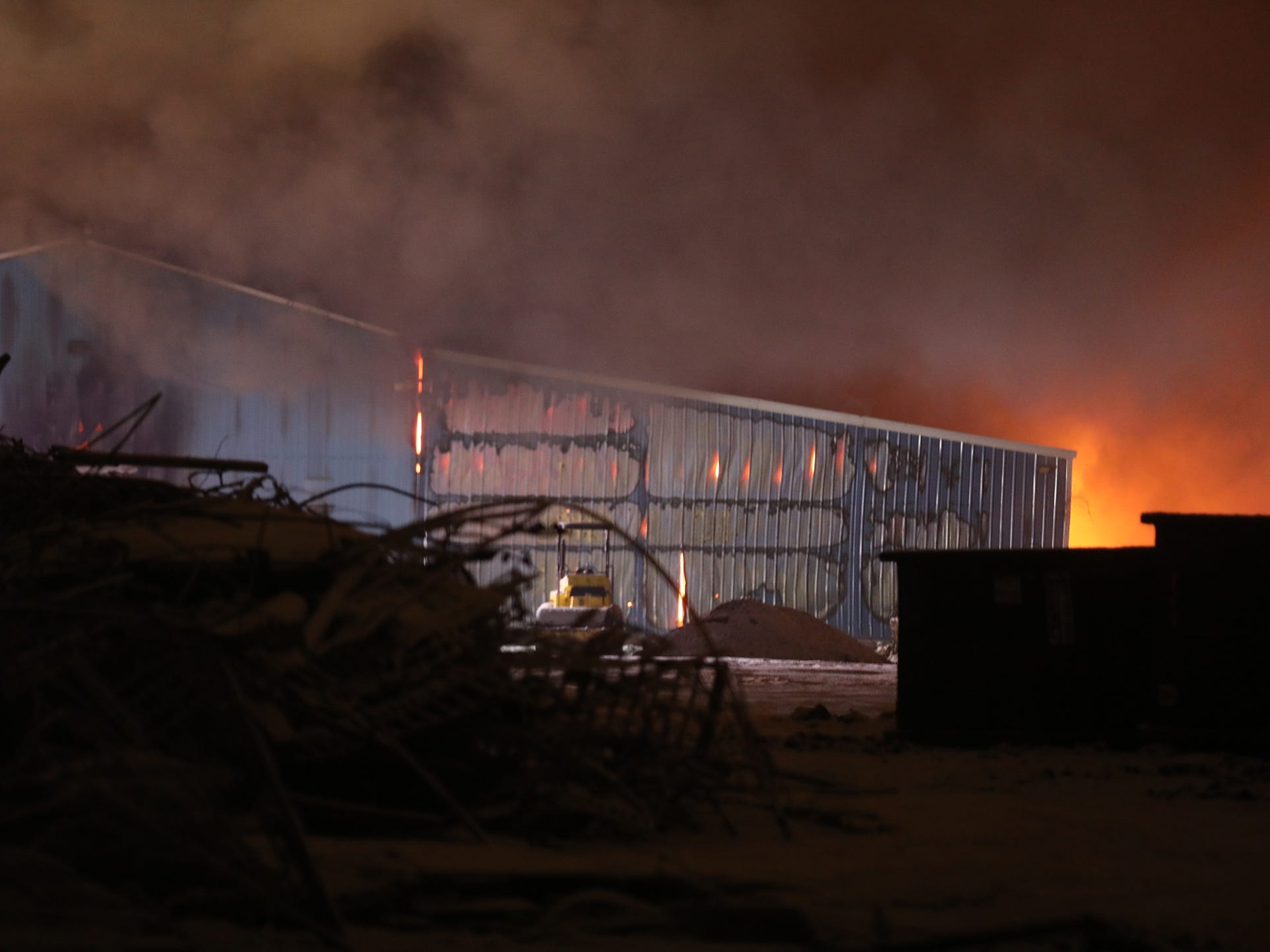Before firefighters opened up the building the glow from the fire could be seen from a block away.