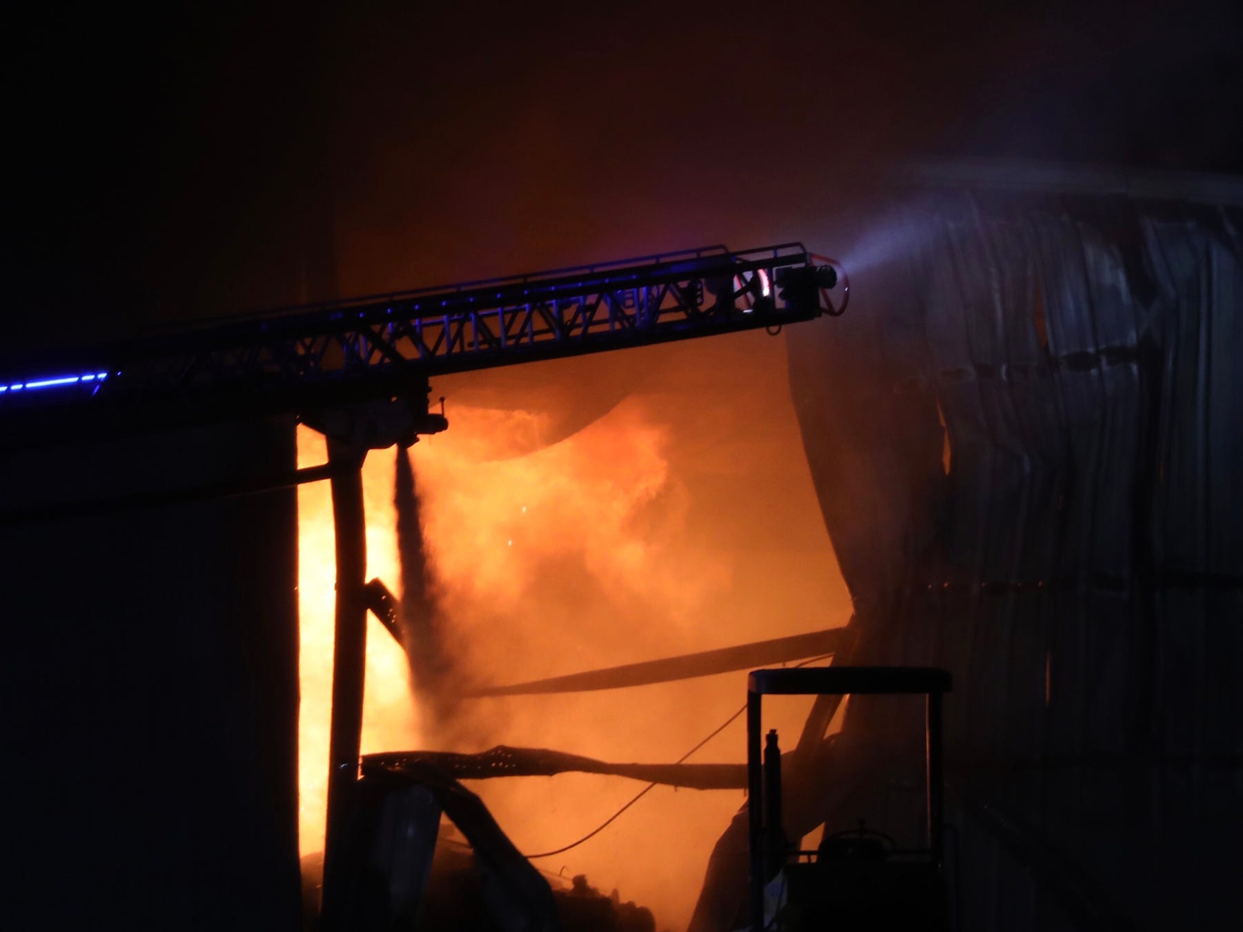 Waves of flames could be seen shooting up toward the ceiling of the large structure.