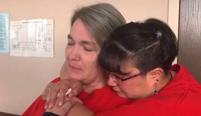 Zackary Dwello's mom, Paula, is hugged as she talks about her son.