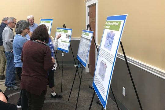 Information posters were set up at the Holiday Inn in Redding on Wednesday  for people to learn about the proposal to raise the height of Shasta Dam.