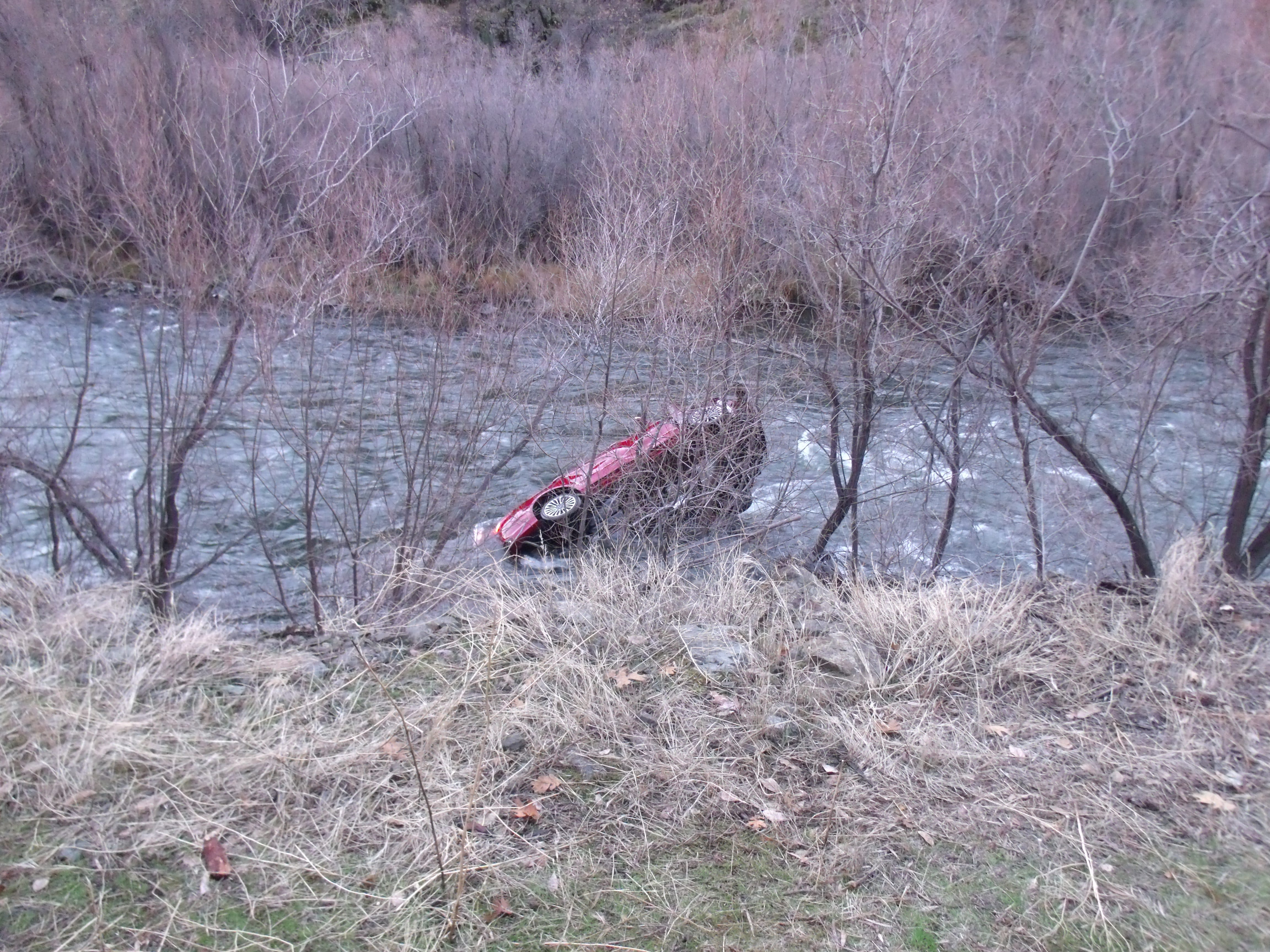 Rescuers pull Michael Finn's Ford Fusion from the Klamath River in this Wednesday, December 12, 2018 picture. Finn survived five hours in the river.