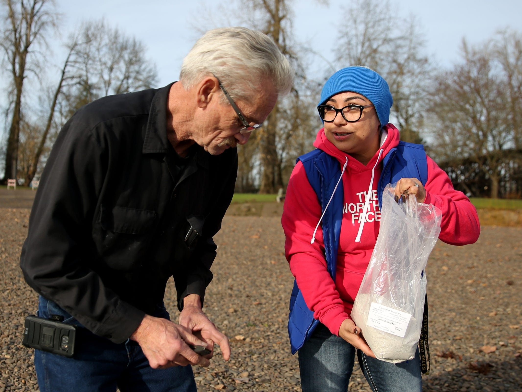Carolina Johnson, a manager at a West Salem Subway, and Richard Blocker, 61, of Vancouver, Wash., prepare to spread the ashes of Blockers' brother, Don Blocker, in the Willamette River at Wallace Marine Park in West Salem on Thursday, Dec. 13, 2018. Blocker lived in the park for about 40 years. He died the day after Thanksgiving, unable to get warm after falling into a pond near his tent. Johnson became friends with him when she used to give him her employee meals at Subway.