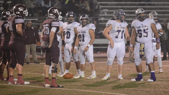 San Saba's offensive line looks to the sideline during the Armadillos' 31-17 win over De Leon on Dec. 6 in a Class 2A Division I state quarterfinal game at Gordon Wood Stadium in Brownwood.