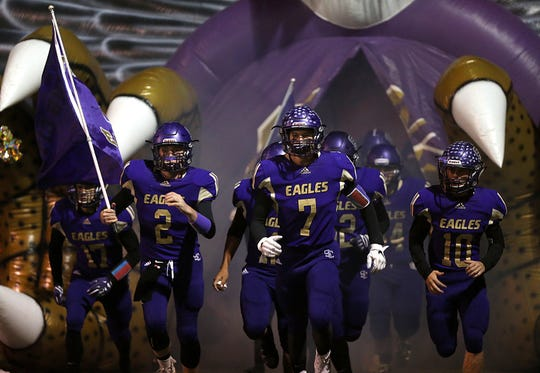 The Sterling City Eagles make their way to the field Friday, Nov. 9, 2018, before their game against Garden City.