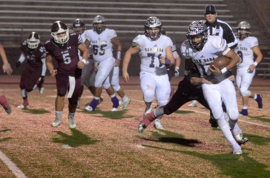San Saba quarterback Sean O'Keefe fights for yardage in the Armadillos' 31-17 win over De Leon in a Class 2A Division I state quarterfinal game at Gordon Wood Stadium on Dec. 6 in Brownwood.