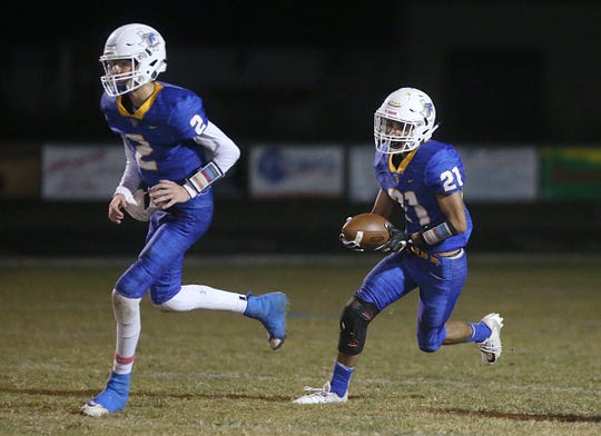 Veribest's Joshua Bolin (#21) is shielded by teammate Hayden Barnes (#2) Friday, Oct. 26, 2018 during their game against the Paint Rock Indians.