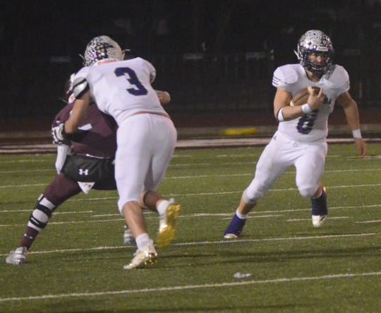 San Saba's Eli Salinas looks for running room during the Armadillos' 31-17 win over De Leon on Dec. 6 in a Class 2A Division I state quarterfinal game at Gordon Wood Stadium in Brownwood.