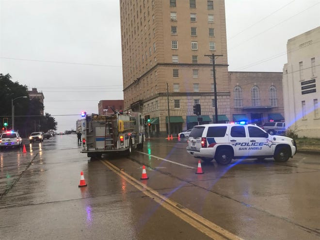 Emergency first responders surround the Cactus Hotel, Dec. 13, 2018, after reports of suspicious package.