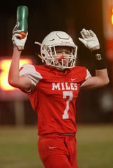 Miles' Seth Michalewicz (7) throws his hands up to signal a touchdown Friday, Nov. 2, 2018, during the Bulldogs' game against Christoval.