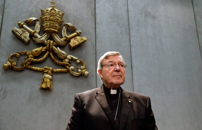 In this Thursday, June 29, 2017. file photo, Cardinal George Pell prepares to make a statement, at the Vatican. Pope Francis has removed two cardinals from his informal cabinet after they were implicated in the Catholic Church's sex abuse and cover-up scandal, shedding embarrassing advisers ahead of a high-stakes Vatican summit on abuse early next year. The Vatican said Wednesday, Dec. 12, 2018 that Francis in October had written to Chilean Cardinal Javier Errazuriz and Australian Cardinal George Pell thanking them for their five years of service on the so-called Group of Nine, or C-9.