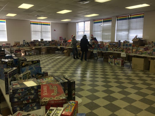 Volunteers wait for recipients to come pick out items at the former Northampton Middle School during the Northampton Angel Tree gift and toy distribution on Thursday, Dec. 13, 2018.