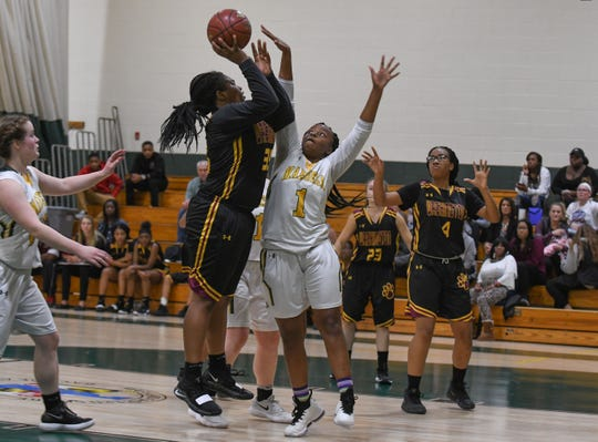Washington High School Senior Guard Danasia Roberts takes a shot against Mardela High School on Tuesday, Dec. 11, 2018.