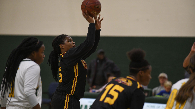 Washington High School Senior Guard Danasia Roberts takes a shoots foul shots against Mardela High School on Tuesday, Dec. 11, 2018.