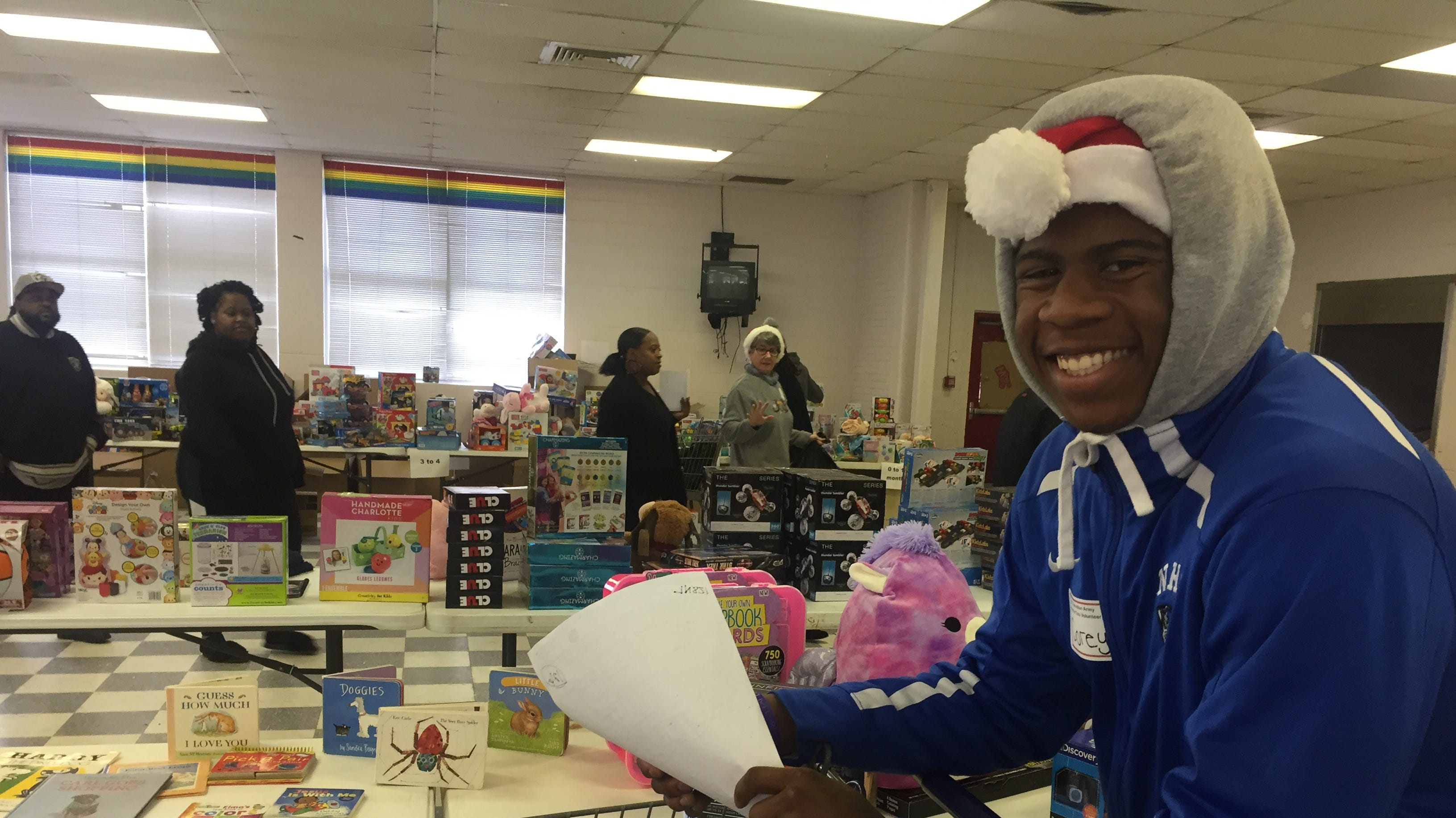 Corey Smith Jr., a Northampton High School senior, volunteers during the Northampton Department of Social Services Angel Tree gift and toy distribution at the former Northampton Middle School in Machipongo, Virginia on Thursday, Dec. 13, 2018.